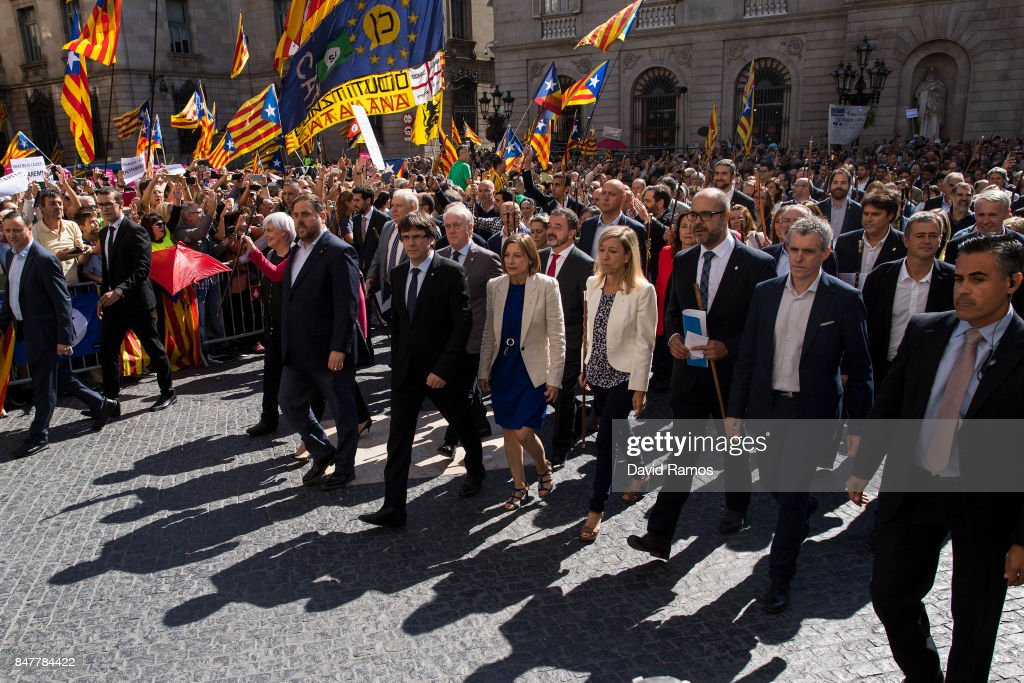 President of Cataonia Carles Puigdemotn (C) leads Catalan mayors during a demonstration on September 16, 2017 in Barcelona, Spain. 712 Catalan mayors who have backed the independence referendum were summoned by Spain's State Prosecutor over the independence vote, threatening arrests over non-cooperation. The vote on breaking away from Spain was called by the Catalan government for October 1, 2017 but was suspended by the Spanish Constitutional Court following a demand from the Spanish Government. Catalan and Spanish security forces have been instructed by Spain's Public Prosecutor's Office to take all the elements which could promote or help to celebrate the referendum. This includes ballots, ballots boxes and promotional material.