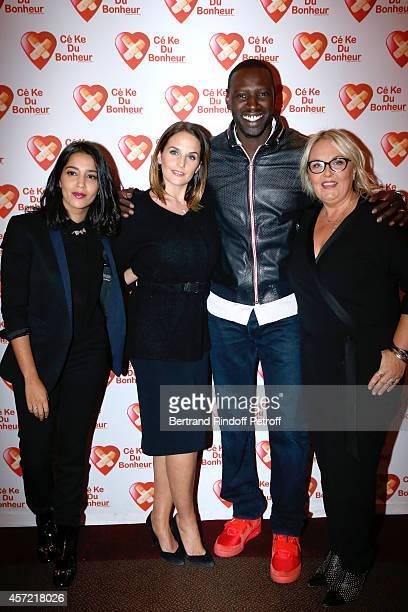 President of 'CekeDuBonheur' Helene Sy and her husband Honorary President of 'CekeDuBonheur' actor Omar Sy standing between godmothers of CKDB Leila...