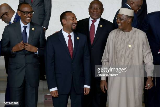 President of Chad Idris Debi Rwandan President Paul Kagame and Ethiopian Prime Minister Abiy Ahmed are seen together ahead of posing for a family...