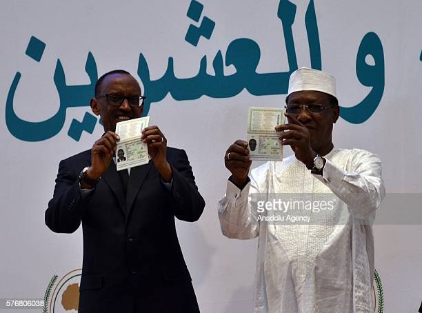President of Chad Idriss Deby and Rwanda's President Paul Kagame show their Africa passport designed to allow free travel throughout African Union...