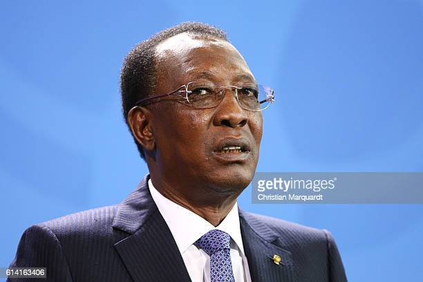 President of Chad Idriss Deby reacts while speaking to the media with German Chancellor Angela Merkel following talks at the chancellory on October...