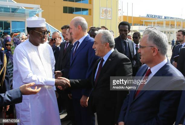 N'DJAMENA CHAD DECEMBER 26 President of Chad Idriss Deby shakes hands with Turkish Economy Minister Nihat Zeybekci Turkish Energy and Natural...