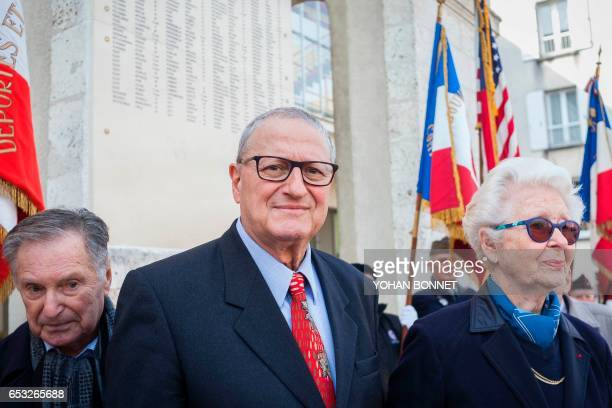 President of Charante Jewish Association Gerard Benguigui poses with Holocaust survivors Robert Frank Francine Christophe during the inauguration of...