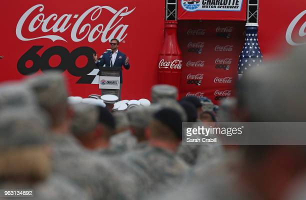 President of Charlotte Motor Speedway Marcus Smith speaks during prerace ceremonies for the Monster Energy NASCAR Cup Series CocaCola 600 at...