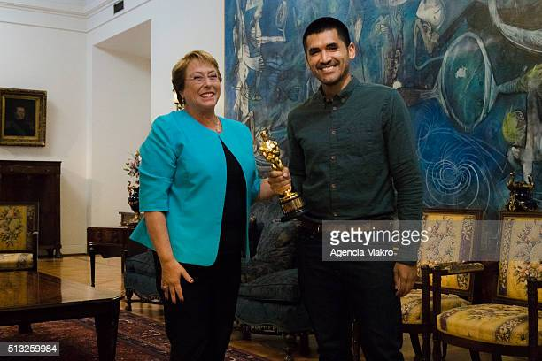 President of Chile Michelle Bachelet and Gabriel Osorio director of the film Bear Story Oscar winner in the best animated short category pose for...