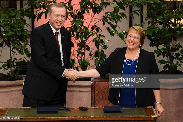 President of Chile Michelle Bachelet and President of Turkey Recep Tayyip Erdogan shake hands after signing a cooperation agreement between Chile and...