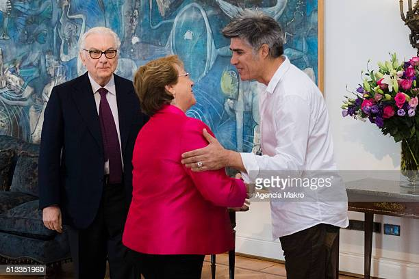 President of Chile Michelle Bachelet greets the Chilean architect Alejandro Aravena Director of the la Biennale di Venezia at La Moneda Palace on...