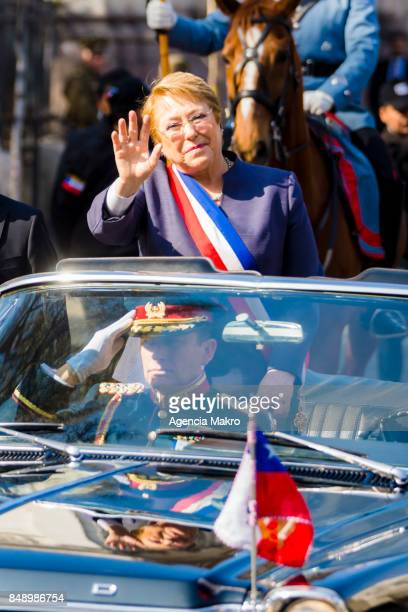 President of Chile Michelle Bachelet greets the crowd during the journey to the Metropolitan Cathedral to participate in the traditional Te Deum...