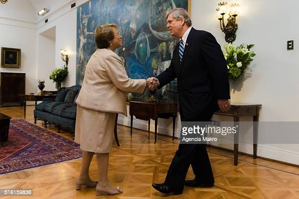 President of Chile Michelle Bachelet greets United States Secretary of Agriculture Thomas Vilsack at Palacio de La Moneda during an official visit on...