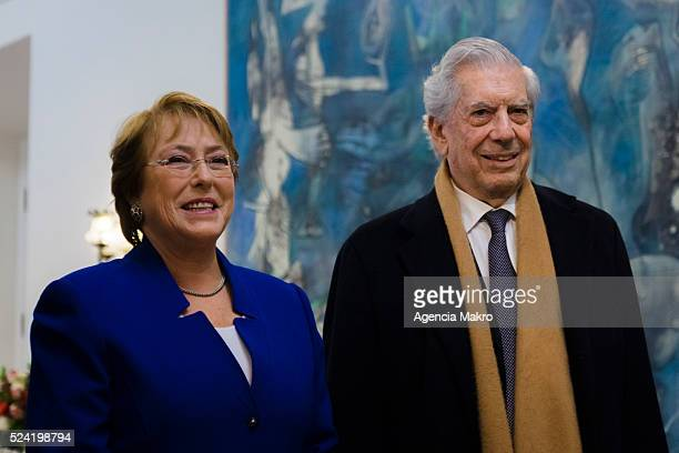 President of Chile Michelle Bachelet poses for pictures next to writer Mario Vargas Llosa during a meeting at Palacio de La Moneda on April 25 2016...