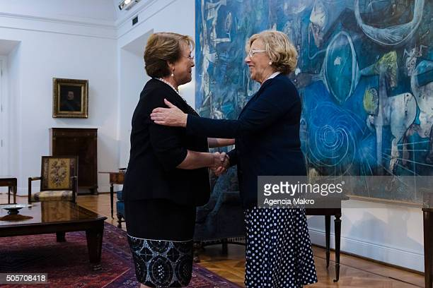 President of Chile Michelle Bachelet talks with the Mayor of Madrid Manuela Carmena at the Audience Hall of the Palacio de la Moneda during an...