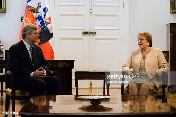 President of Chile Michelle Bachelet talks with United States Secretary of Agriculture Thomas Vilsack at Palacio de La Moneda during an official...
