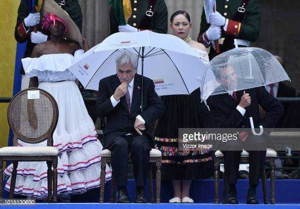 President of Chile Sebastian Piñera gestures next to President of Mexico Enrique Peña Nieto during the swearing in ceremony of newly elected...