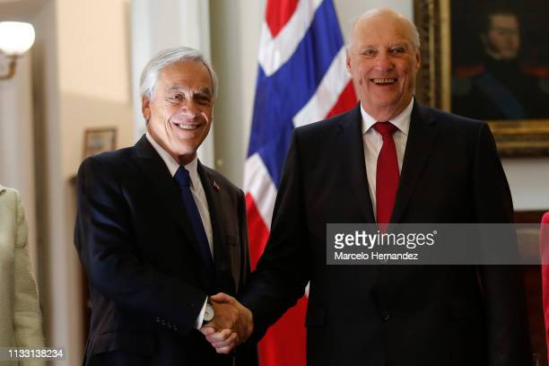 President of Chile Sebastian Piñera shakes hands with King Harald V and Queen Sonja of Norway at La Moneda Palace during Day 2 of the visit of...