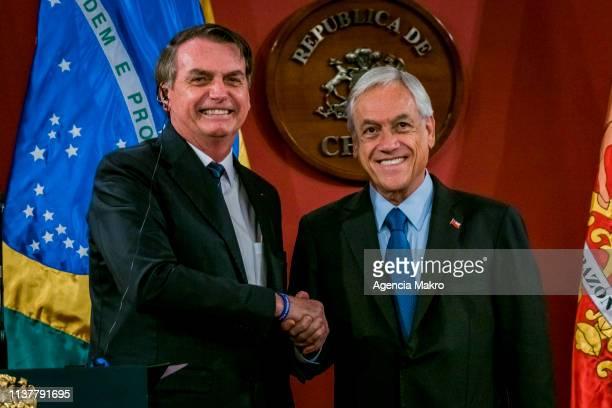 President of Chile Sebastián Piñera and President of Brazil Jair Bolsonaro shake hands during a bilateral meeting at the Palacio de La Moneda on...