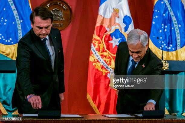 President of Chile Sebastián Piñera and President of Brazil Jair Bolsonaro sign collaboration agreements between countries after a bilateral meeting...