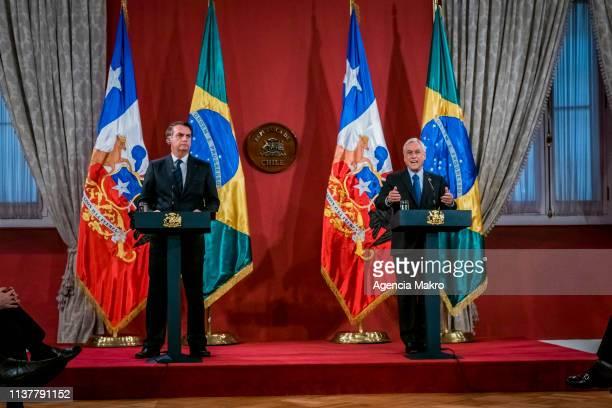 President of Chile Sebastián Piñera and President of Brazil Jair Bolsonaro speak after a bilateral meeting at the Palacio de La Moneda on March 23...