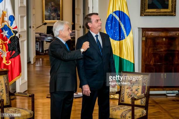 President of Chile Sebastián Piñera and President of Brazil Jair Bolsonaro talk during a bilateral meeting at the Palacio de La Moneda on March 23...