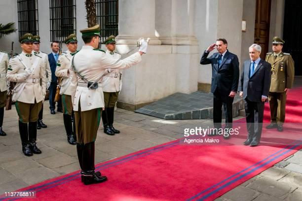 President of Chile Sebastián Piñera and President of Brazil Jair Bolsonaro receive the honors of the Palace Guard at the Palacio de La Moneda on...