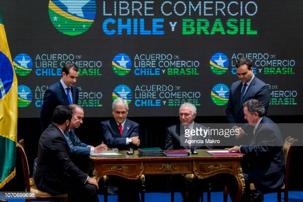 President of Chile Sebastián Piñera and President of Brazil Michel Temer observe the signing of a Free Trade Agreement between both countries by the...