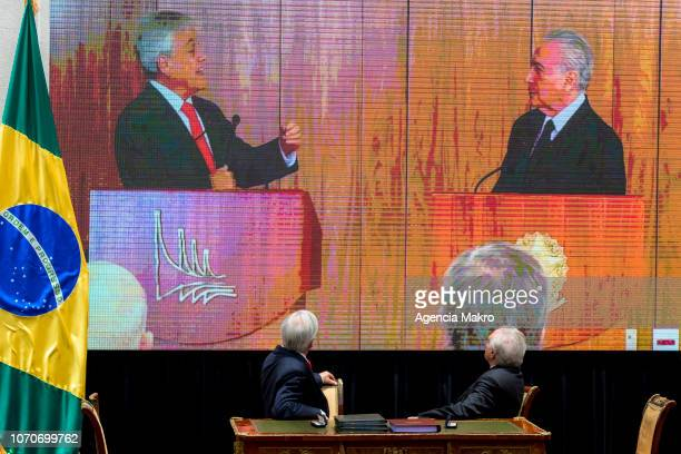 President of Chile Sebastián Piñera and President of Brazil Michel Temer watch themselves on a screen during the signing ceremony of a Free Trade...