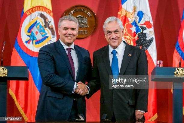 President of Chile Sebastián Piñera and President of Colombia Iván Duque shake hands after a bilateral meeting at the Palacio de La Moneda on March...