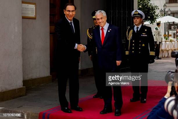 President of Chile Sebastián Piñera and President of Peru Martín Vizcarra shake hands when they arrive at the Palacio de La Moneda on November 27...