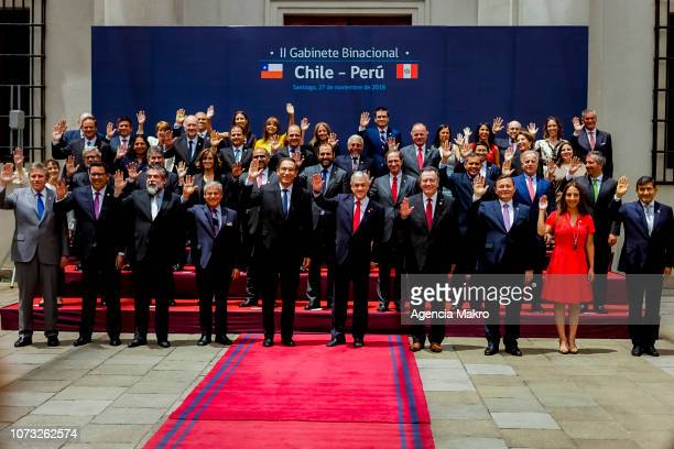 President of Chile Sebastián Piñera and the President of Peru Martín Vizcarra pose in the official photo with the ministers of their countries at the...