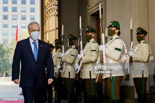 President of Chile Sebastián Piñera enters the Palacio de La Moneda for the official family photo during the Independence Day celebrations on...