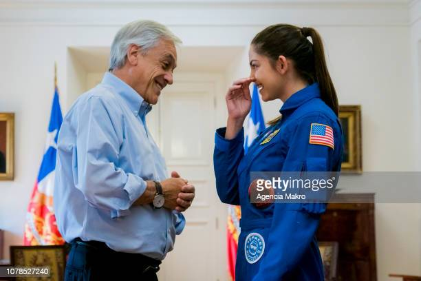 President of Chile Sebastián Piñera laughs with Alyssa Carson an aspiring astronaut who is preparing for an eventual manned mission to Mars during a...
