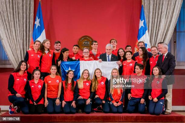 President of Chile Sebastián Piñera poses with the athletes who will represent Chile in the XI South American Games of Cochabamba 2018 on May 22 2018...