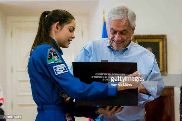 President of Chile Sebastián Piñera receives a gift from Alyssa Carson an aspiring astronaut who is preparing for an eventual manned mission to Mars...