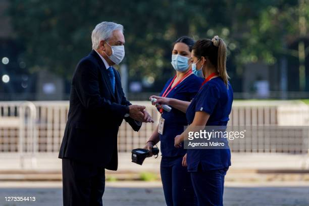 President of Chile Sebastián Piñera receives hand sanitizer when entering the Palacio de La Moneda for the official family photo during the...