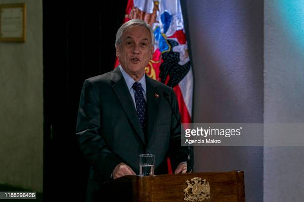 President of Chile Sebastián Piñera speaks during a press conference after four days of silence and following the referendum agreement to reform the...