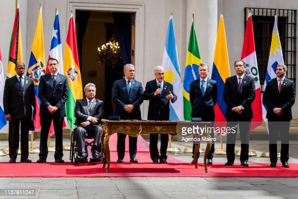 President of Chile Sebastián Piñera speaks together with the Ambassador of Guyana in Brazil George Wilfred Talbot President of Brazil Jair Bolsonaro...