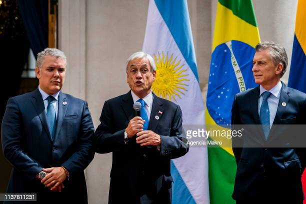 President of Chile Sebastián Piñera speaks together with the President of Colombia Iván Duque President of Argentina Mauricio Macri at the end of the...