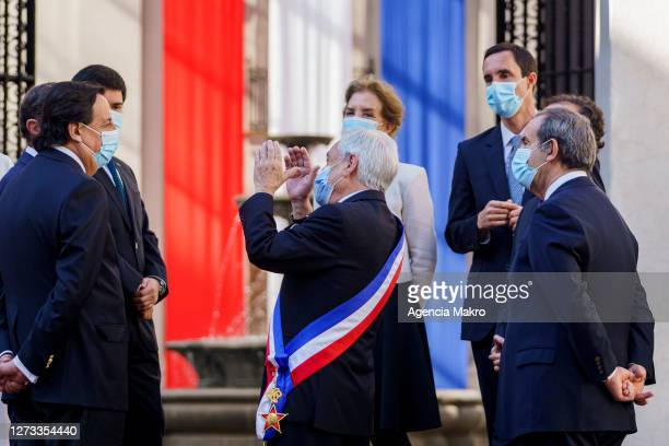 President of Chile Sebastián Piñera talks with members of the Cabinet of Ministers after the official family photo during the celebrations of...