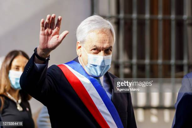 President of Chile Sebastián Piñera waves to the media after the official family photo with the Cabinet of Ministers during the Independence Day...
