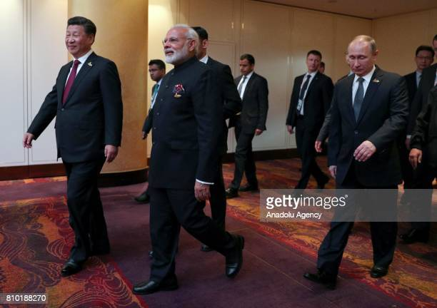 President of China Xi Jinping Prime Minister of India Narendra Modi and President of Russia Vladimir Putin arrive to attend a meeting of BRICS...