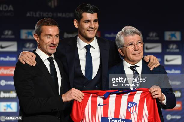 President of Club Atletico de Madrid Enrique Cerezo and the club's Italian sports director Andrea Berta pose with Chelsea's former player Spanish...