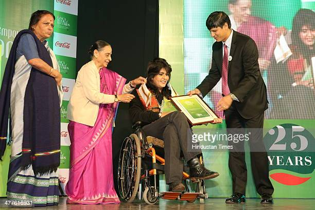 President of Coca Cola India South West Asia Venkatesh Kini presents Limca Book of Records' People of the Year 2014 award to Arjuna Awardee...