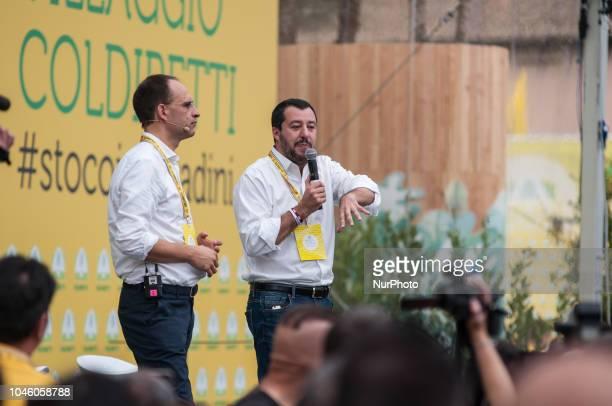 President of Coldiretti Roberto Moncalvo and Italian Interior Minister and Deputy Premier Matteo Salvini speaks as he visits a Coldiretti Italian...