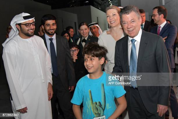President of Colombia Juan Manuel Santos and his wife Maria pose for a picture during the opening of the Louvre Abu Dhabi Museum on November 11 2017...