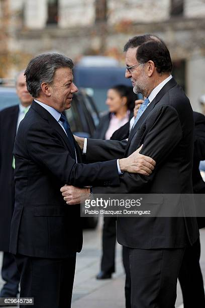 President of Colombia Juan Manuel Santos and Spanish Prime Minister Mariano Rajoy congratulate each other as they arrive at the Premio Nueva Economia...