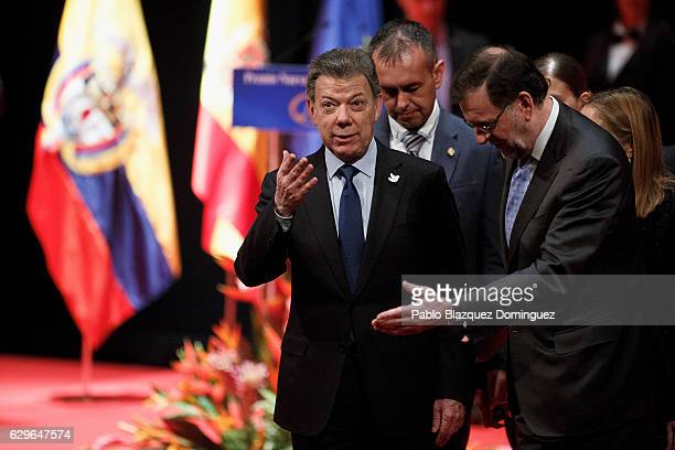 President of Colombia Juan Manuel Santos and Spanish Prime Minister Mariano Rajoy gesture as they leave the Premio Nueva Economia Forum 2016 ceremony...
