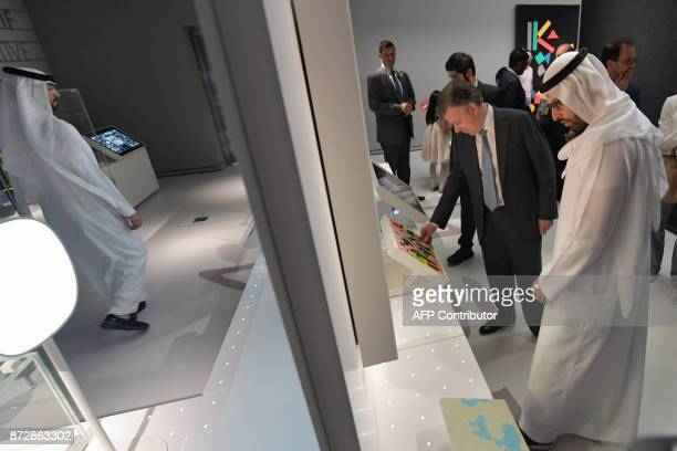 President of Colombia Juan Manuel Santos is escorted by Mohamad Khalifa alMubarak the chariman of Abu Dhabi tourism and culture authority during the...