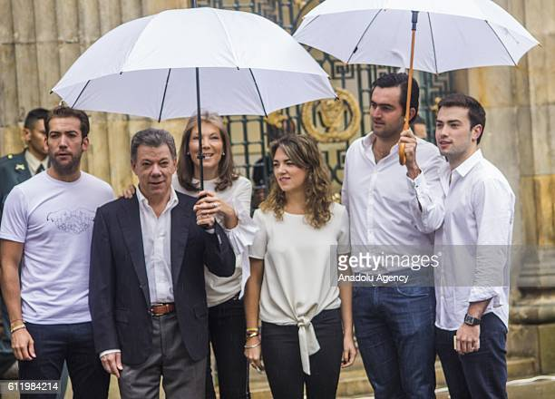 President of Colombia Juan Manuel Santos poses for a family photo before he casts his vote during a referendum on a peace to finish the guerrilla war...