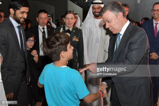 President of Colombia Juan Manuel Santos poses for a picture during the opening of the Louvre Abu Dhabi Museum on November 11 2017 on Saadiyat island...