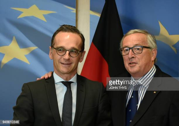 President of Commission JeanClaude Juncker welcomes German foreign minister Heiko Maas before to their bilateral meeting on April 13 2018 at the EU...