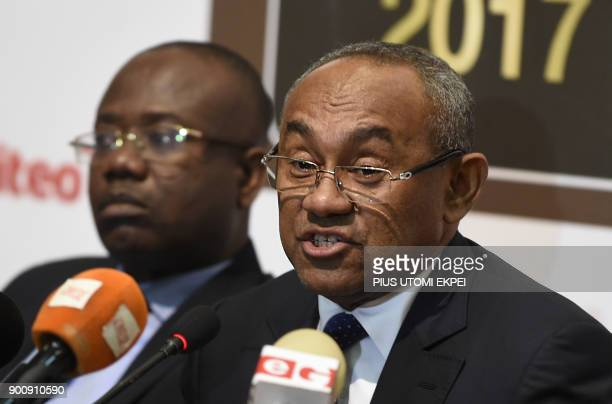 President of Confederation of African Football Ahmad Ahmad speaks next to the first vicepresident Kwesi Nyantakyi during a press conference on the...